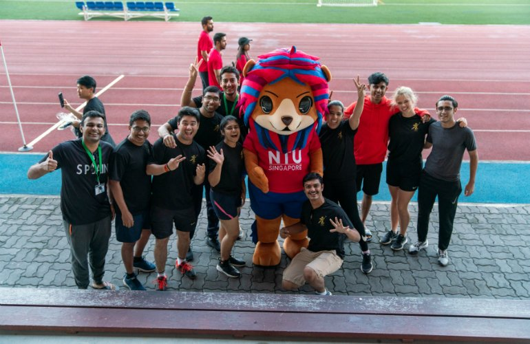 SP Jain students pose for a picture with the mascot