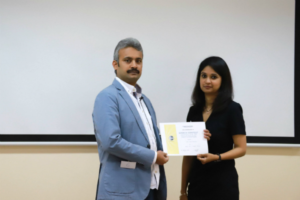 AB Lakshmanan (EMBA Alumni - Batch 39) was presented a certificate of participation by veteran Toastmasters TM Anitha